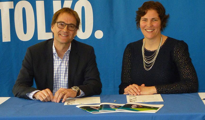 Brad Thorlakson, President & CEO, Tolko Industries Ltd. signs the Diversity Pledge to mark a commitment for gender parity with Minerva BC's Interim CEO, Tina Strehlke